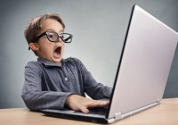 shocked-and-surprised-boy-on-the-internet-with-laptop-computer--brian-jackson